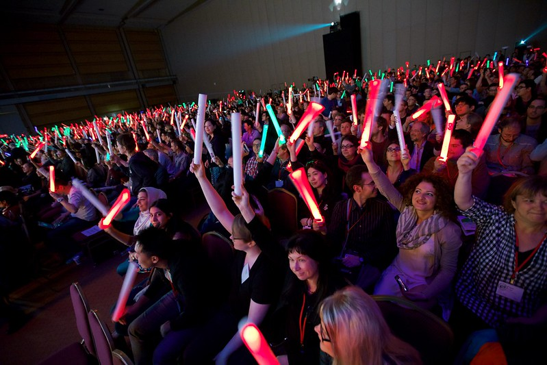 Closing plenary at CHI 2015 with the audience holding glow sticks.